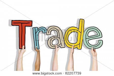 Diverse Hands Holding the Word Trade