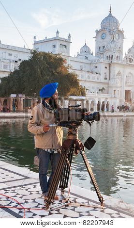 Cameraman At Golden Temple In The Early Morning. Amritsar. India