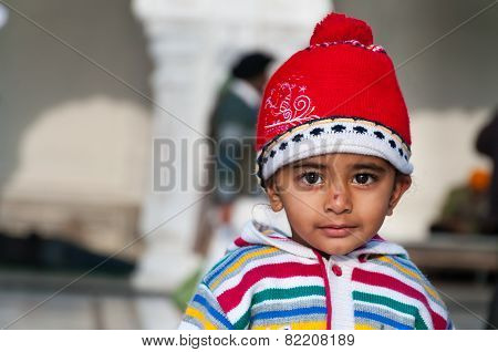 Child In Golden Temple. Amritsar. India