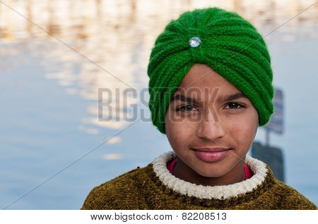 Indian Sikh Boy In Golden Temple. Amritsar. India
