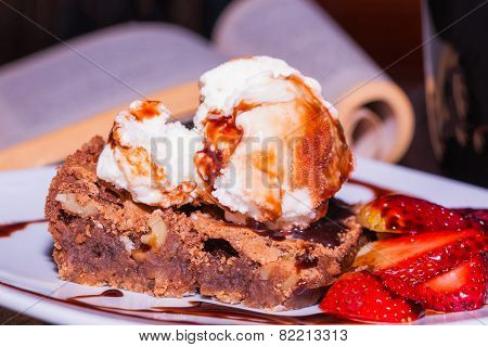 Brownie with ice cream and strawberry, delicious dessert