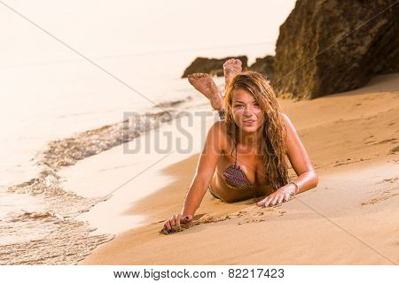 young woman in jeans on the beach