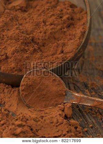 cocao powder in the metal spoon