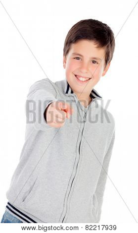 Smiling teenage boy of thirteen indicating something isolated on white background