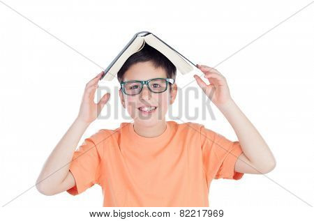 Funny teenage boy of thirteen with a book on head isolated on white background