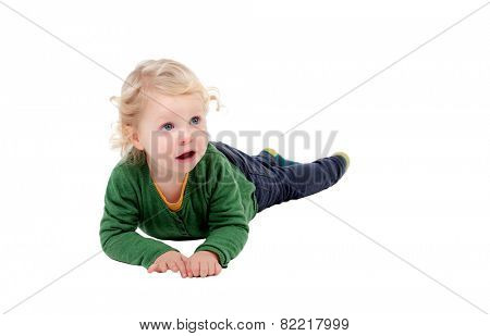 Adorable blond baby lying on the floor isolated on a white background