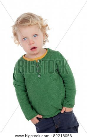 Adorable blond baby with hands in the pockets isolated on a white background