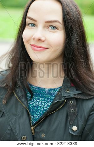 Autumn young woman portrait smiling outdoors