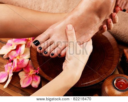 Massage of woman's foot in spa salon - Beauty treatment concept