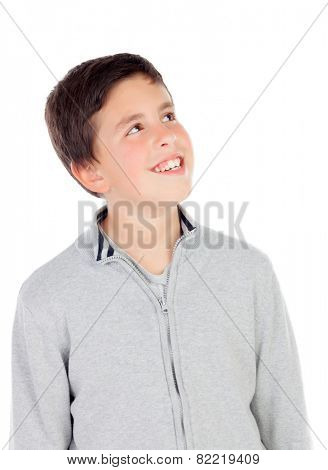 Smiling teenage boy of thirteen looking up isolated on white background