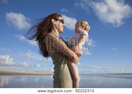 Happy Mom With Baby Between Clouds