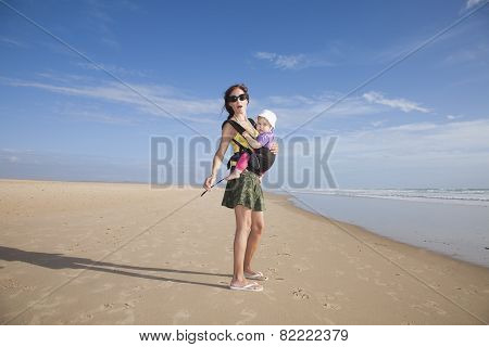 Miniskirt Mom With Baby In Rucksack