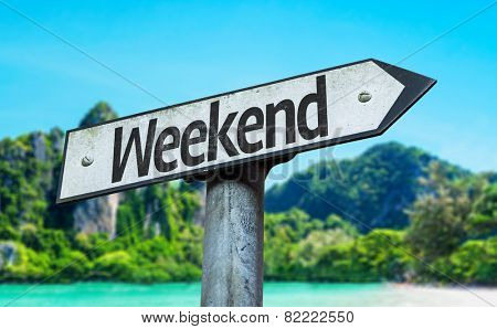 Weekend sign with a beach on background