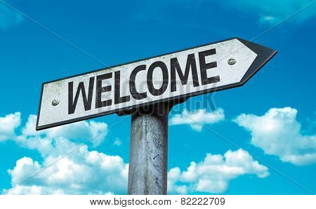 Welcome sign with sky background