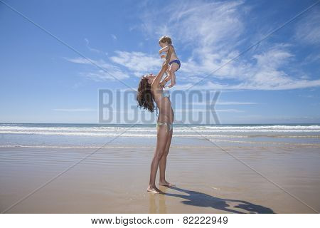 Woman With Baby Up In Her Arms
