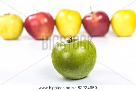 apples in a line with a close-up of green ripe apple