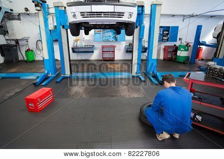 Mechanic working on a tire wheel at the repair garage