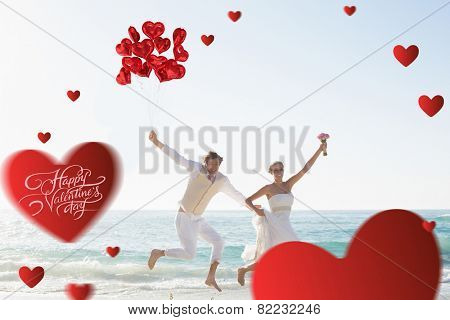 Heart balloons against newlyweds having fun holding balloons