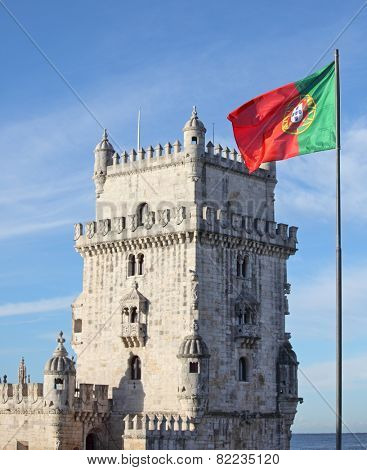 Belem Tower in Lisbon and Portuguese national flag