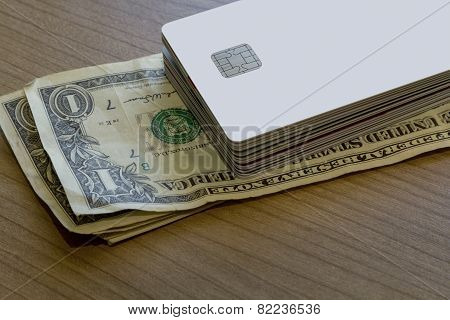 Batch Of Credit Or Debit Card On Dollar Notes