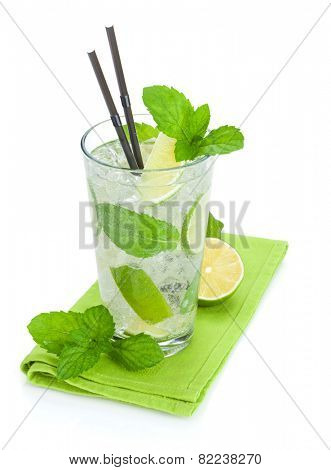 Fresh mojito cocktail and limes with mint. Isolated on white background
