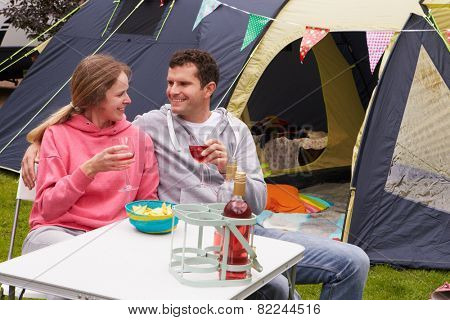 Couple Enjoying Camping Holiday On Campsite