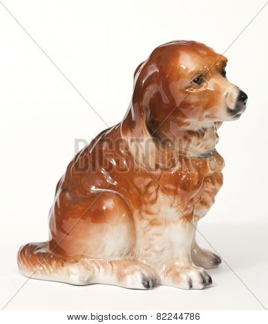 English Shepherd puppy. Ceramic figurine, dog breed isolated on white