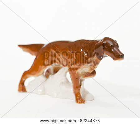 Irish red Setter. Ceramic figurine, dog breed isolated on white