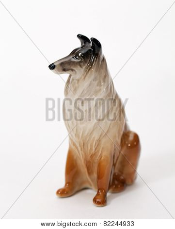 Collie. Ceramic figurine, dog breed isolated on white