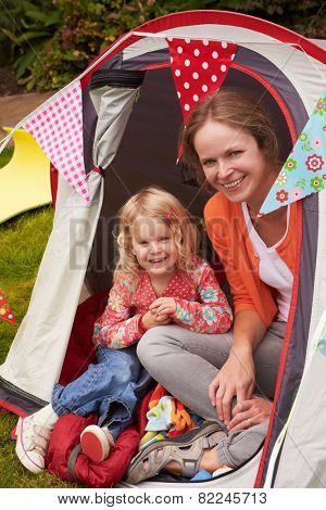 Mather And Daughter Enjoying Camping Holiday On Campsite