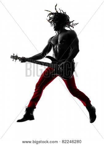 one african man guitarist bassist player playing in studio silhouette isolated on white background