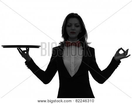one  woman waiter butler holding empty tray zen gesturing in silhouette on white background
