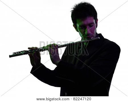one caucasian man  playing traverse flute player in studio silhouette isolated on white background