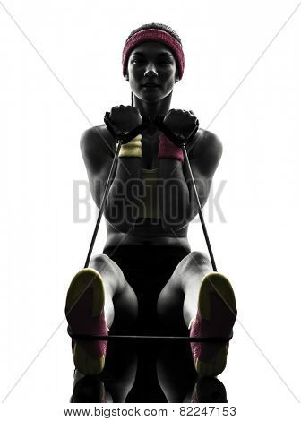 one woman exercising fitness workout resistance bands in silhouette on white background