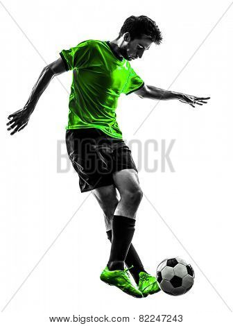 one soccer football player young man dribbling in silhouette studio on white background