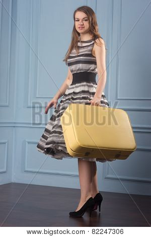 Girl In Old-fashioned Polka-dot Dress With Old Suitcase