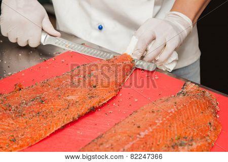 Chef Cutting Salmon Fish