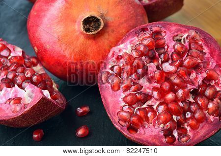 Red fruit Pomegranate on table