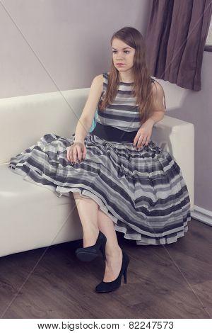 Beauty Woman Sitting On Sofa