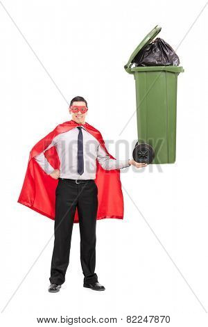 Full length portrait of a superhero holding a large trash can isolated on white background