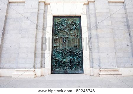 Sculpted Entrance Gate From Cathedral Almudena On A Spring Day In Madrid