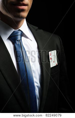 detail photo ace card in his suit pocket
