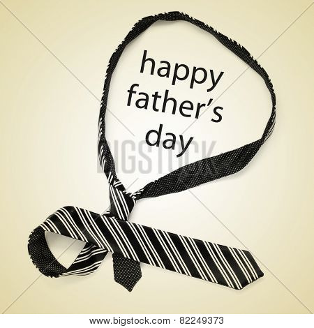 a necktie and the sentence happy fathers day on a beige background, with a retro effect