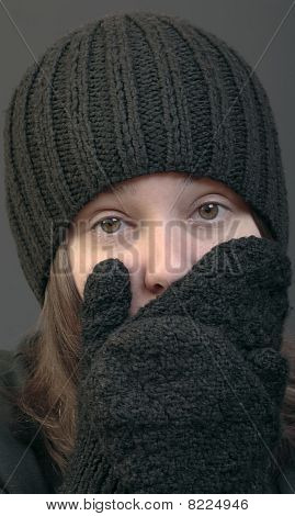 Woman In Woolen Cap