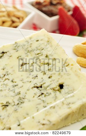 closeup of a plate with a piece of Roquefort cheese, on a set table