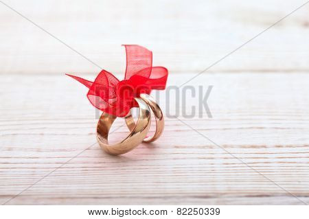 Wedding Decoration Rings With Red Ribbon.