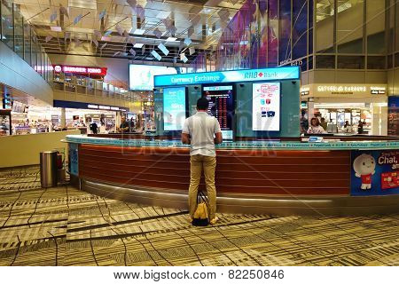 A Customer Is Exchanging Currency In The Kiosk In Singapore Changi Airport