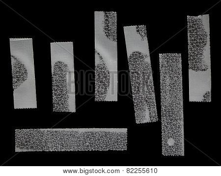 White Transparent Scotch Tape On Faux Black Leather Isolated On Black