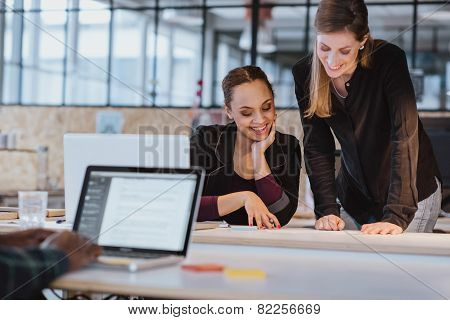 Two Young Woman Working On A New Creative Design