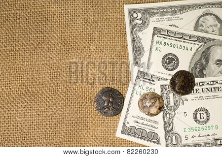 Ancient Coin With Portrait  And Dollar Notes On Sacking